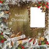 Christmas greeting card with frame, gifts, pine branches and Christmas decorations Royalty Free Stock Photography