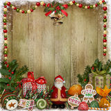 Christmas greeting card with frame, Santa, gifts and candies Stock Photo