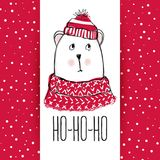 Christmas greeting card with funny bear. Hand drawn vector teddy. With red sweater, scarf and hat. Happy New Year illustration. Winter design. Happy holidays Stock Photo