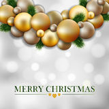 Christmas greeting card, garland of fir twigs,gold balls Royalty Free Stock Photos