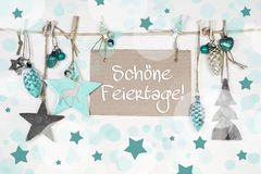Christmas greeting card with german text: Merry holidays. Stock Photo