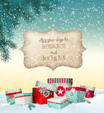 Christmas greeting card with gift boxes in  Royalty Free Stock Photo