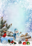 Christmas greeting card with gifts, snowman, pine branches and christmas decorations with space for text. Blue snowy background with snowman, gifts and pine Royalty Free Stock Images