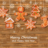 Christmas greeting card with gingerbread cookies Stock Photos