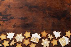 Christmas greeting card with gingerbread cookies on wooden background. Top view with space for your greetings. Flat lay stock photography