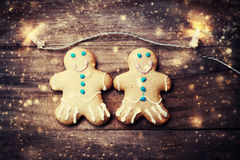 Christmas greeting card with gingerbread man cookie and snowstor Stock Photography