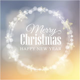 Christmas greeting card with glittering bokeh lights wreath, stars,  Royalty Free Stock Photography