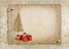 Christmas greeting card with gold metal firtree. And presents on the abstract background Stock Photography
