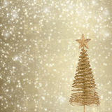 Christmas greeting card with gold metal firtree Stock Photos