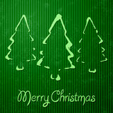 Christmas greeting card with green background Stock Photos