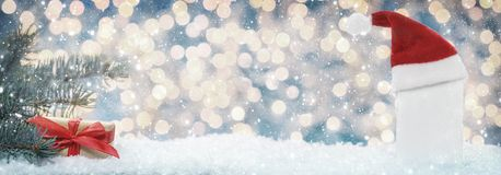 Christmas greeting card with Christmas hat, fir and gift. As banner Royalty Free Stock Image