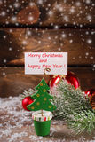 Christmas greeting card holder on wooden table Stock Images