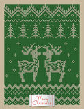 Christmas greeting card with knitted deers Stock Photo