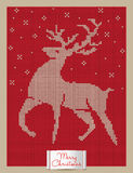 Christmas greeting card with knitted reindeer Stock Photos