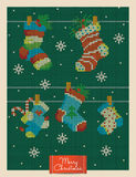 Christmas greeting card with knitted xmas socks Stock Images