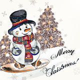 Christmas greeting card with  little pretty snowmen on a snowboa Stock Photos