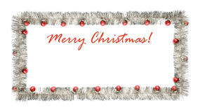Christmas greeting card made of silver tinsel frame with red christmas balls Royalty Free Stock Image