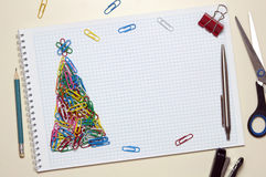 Christmas greeting card made of stationery. Christmas greeting card made of colorful clips and other office supplies Stock Photography