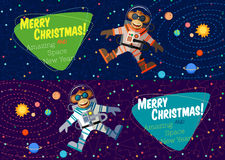 Christmas greeting card: Merry Christmas and New Year. Christmas greeting card: Merry Christmas and amazing space New Year. Monkey astronaut in outer space in Royalty Free Stock Photography
