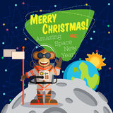 Christmas greeting card: Merry Christmas and New Year. Christmas greeting card: Merry Christmas and amazing space New Year. Monkey astronaut in outer space оn Stock Images
