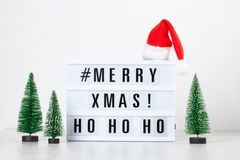 Christmas greeting card mock up. Light box with the text Merry X. Mas and Christmas decoration. Seasons greetings concept royalty free stock photo