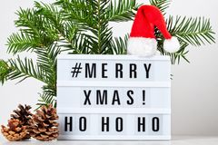 Christmas greeting card mock up. Light box with the text Merry X. Mas and Christmas decoration. Seasons greetings concept stock photography