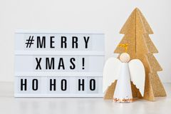 Christmas greeting card mock up. Light box with the text Merry X. Mas and Christmas decoration. Seasons greetings concept stock images