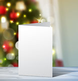 Christmas Greeting Card mock up. Vertical Vector for your design ideas on blured Christmas tree background Stock Images