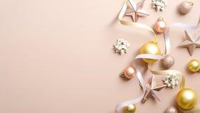 Christmas Greeting Card Mockup With Elegant Decorations, Gold Xmas Balls, Pink Stars, Ribbon On Pastel Ivory Background. Happy New Stock Photography