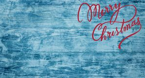Christmas greeting card on old azure wood background. Top view. Space for text stock photography