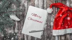 Christmas greeting card on old wooden background with space where you can leave a message for Santa. Stock Photos