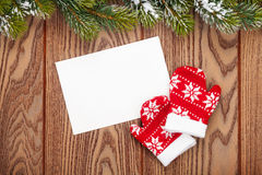 Christmas greeting card or photo frame and mittens over wooden t Stock Image