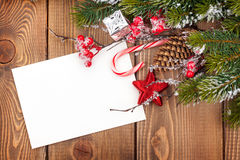 Christmas greeting card or photo frame over wooden table with sn royalty free stock image