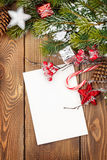 Christmas greeting card or photo frame over wooden table with sn. Ow fir tree. View from above Stock Photo