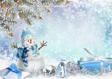 Christmas greeting card with pine branches, snowman and gifts Royalty Free Stock Photo