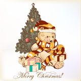 Christmas greeting card with plush bear and Christmas tree Royalty Free Stock Images