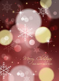 Christmas greeting card or postcard with blurred circles and snowflakes. Royalty Free Stock Photography