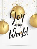 Christmas. Greeting card with realistic gold Christmas balls and confetti. Joy to the World lettering banner design Stock Photos