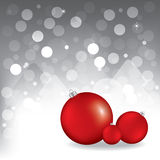 Christmas greeting card with red balls. Gray background Royalty Free Stock Photography