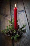 Christmas greeting card with a red candle Stock Photos