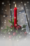 Christmas greeting card with a red candle Stock Photo