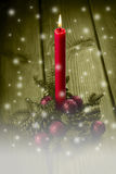 Christmas greeting card with a red candle Royalty Free Stock Photo