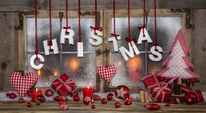 Christmas greeting card in red, wood, candles and with text. stock images