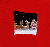 Christmas greeting card with red wrapping paper stock photography