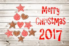 Christmas greeting card 2017, rustic ornaments on wood planks background Royalty Free Stock Image