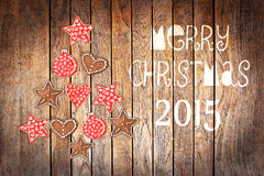 Christmas greeting card 2015, rustic ornaments on wood planks background Royalty Free Stock Photos