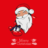Christmas greeting card with Santa Claus hands you a gift. Royalty Free Stock Image
