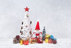 Christmas greeting card. Santa gnome background with gifts and snow. Stock Photo