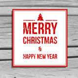 Christmas greeting card, scratchy text on the old wood background Stock Images