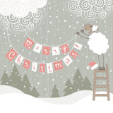 Christmas greeting card. Greeting card with sheep hanging christmas decoration Stock Photography
